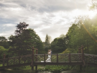 Bride & Groom on bridge at Bryngarw country house