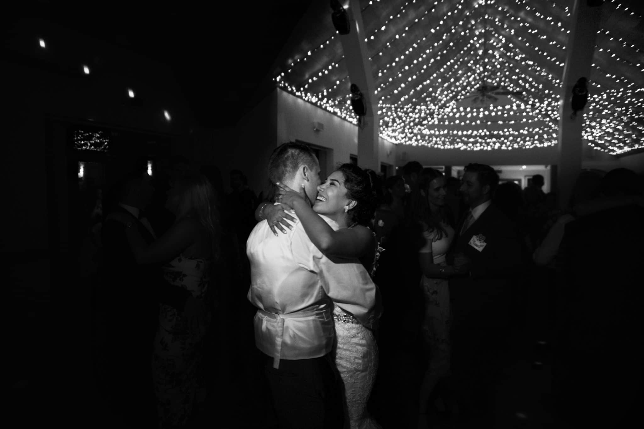 Bride & Groom embrace during first dance at Canada Lodge & Lake