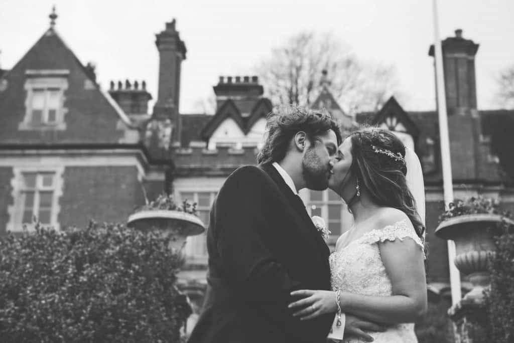 Bride & Groom Kissing wedding photographers cardiff