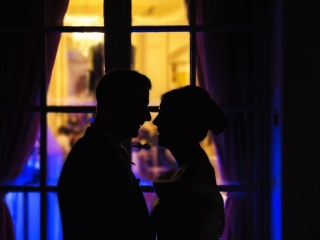 Couple silhouetted against window - wedding photographers cardiff