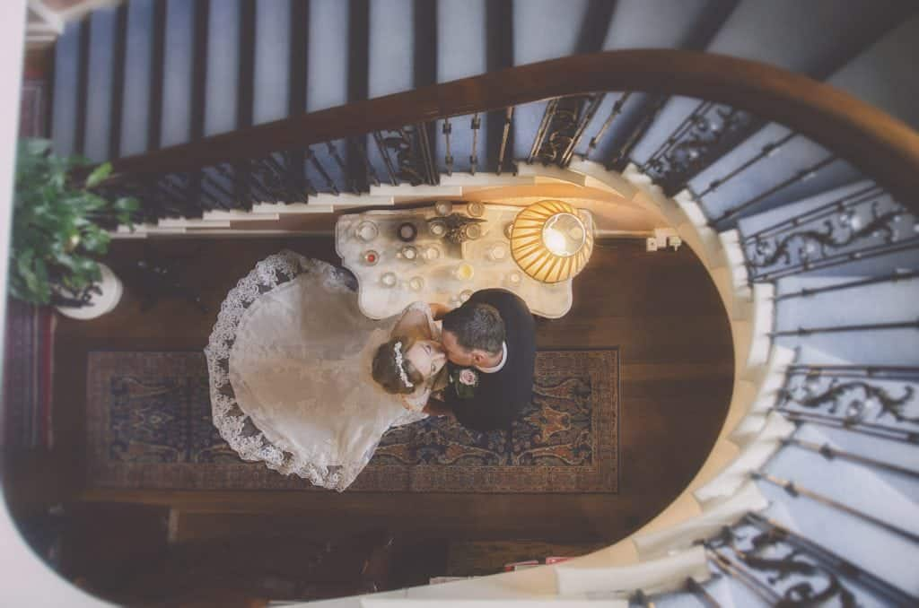Bride & Groom kiss in stairwell wedding photographers cardiff