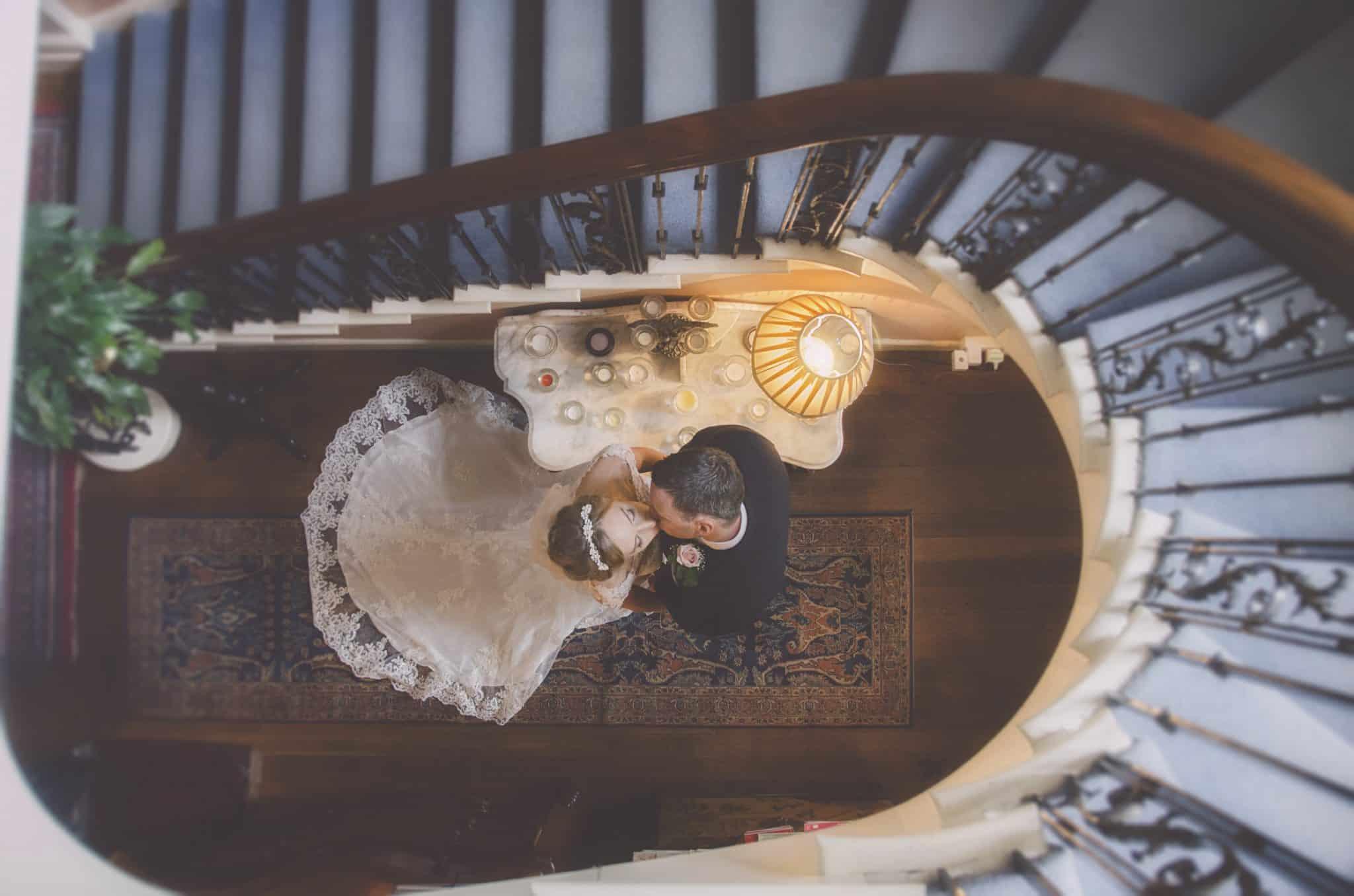 Bride & Groom kiss in stair well