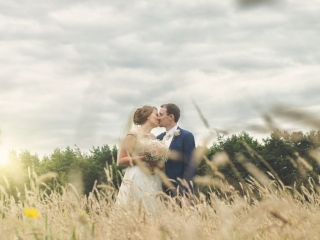 Bride & Groom kiss on corn field wedding photographers cardiff