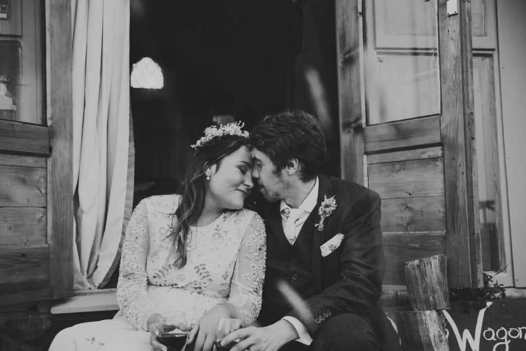 Bride & groom embrace wedding photographers cardiff