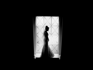 Bride stood in window wedding photographers cardiff