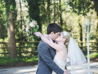 Bride & Groom Kissing wedding photographers cardiff