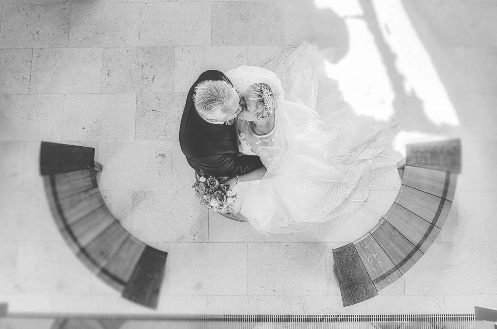 Bride & Groom photographed from above kissing