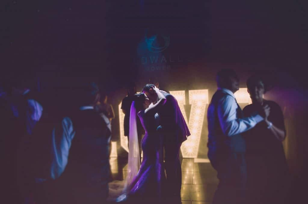 Bride and Groom kiss on the dance floor during disco