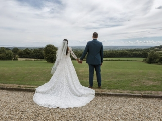 Bride & Groom look out over Valley wedding photographers cardiff