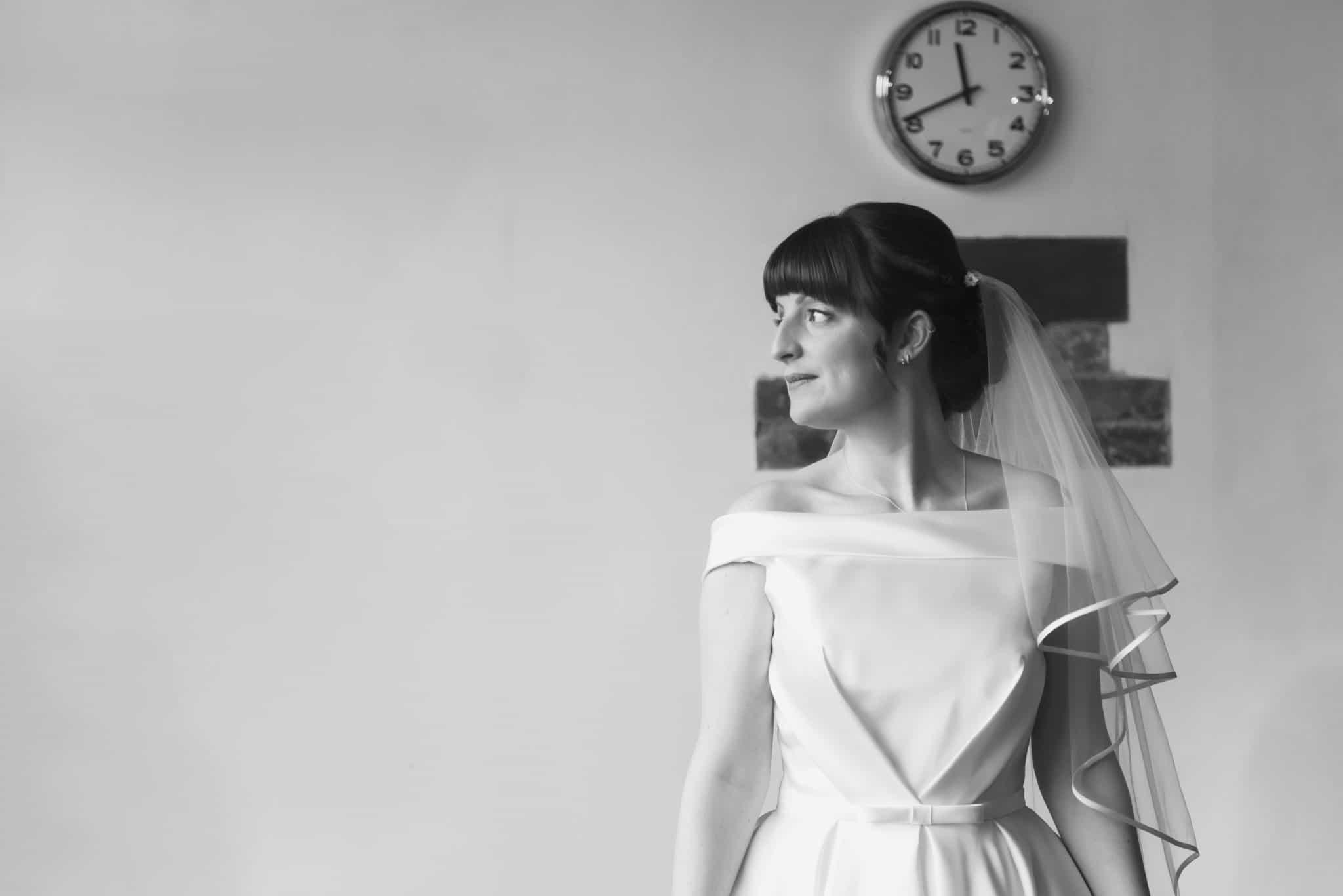 Bride stood looking right wedding photographers cardiff