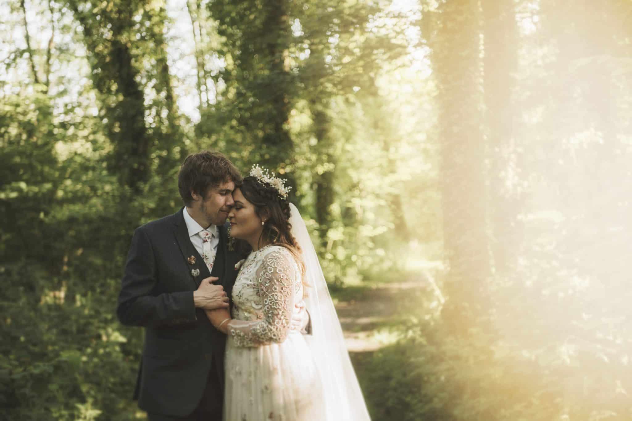 Bride & Groom embrace in woodland wedding photographers cardiff