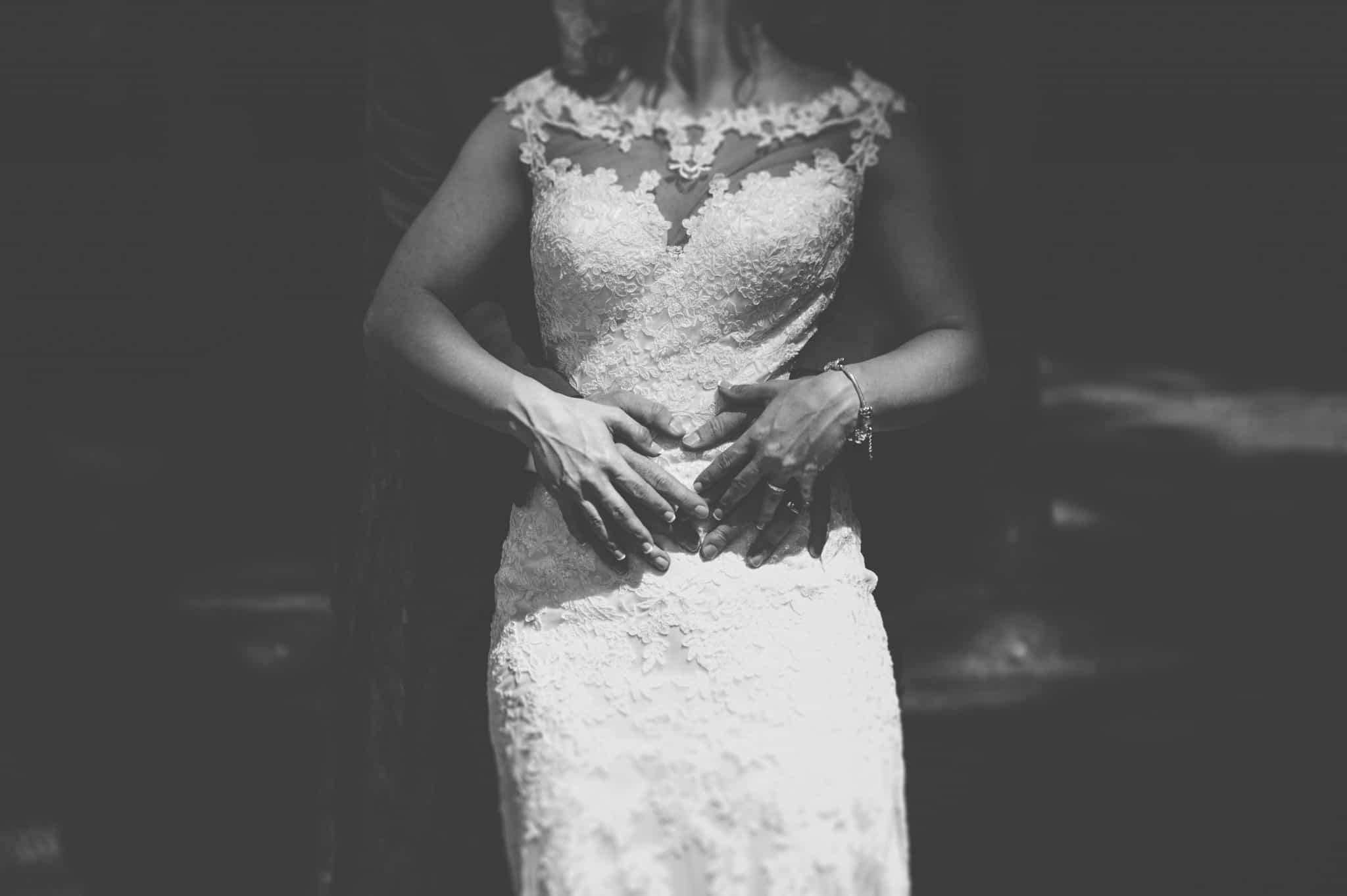 Couple stand with hands on waist wedding photographers cardiff