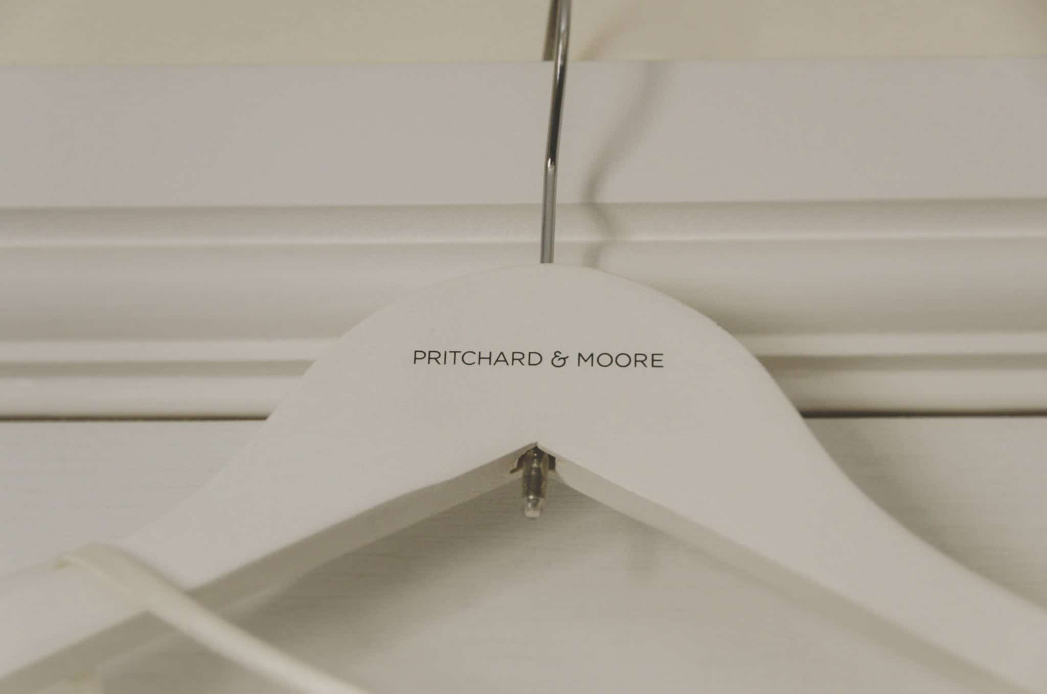 Coat hanger with Pritchard and Moore written on it
