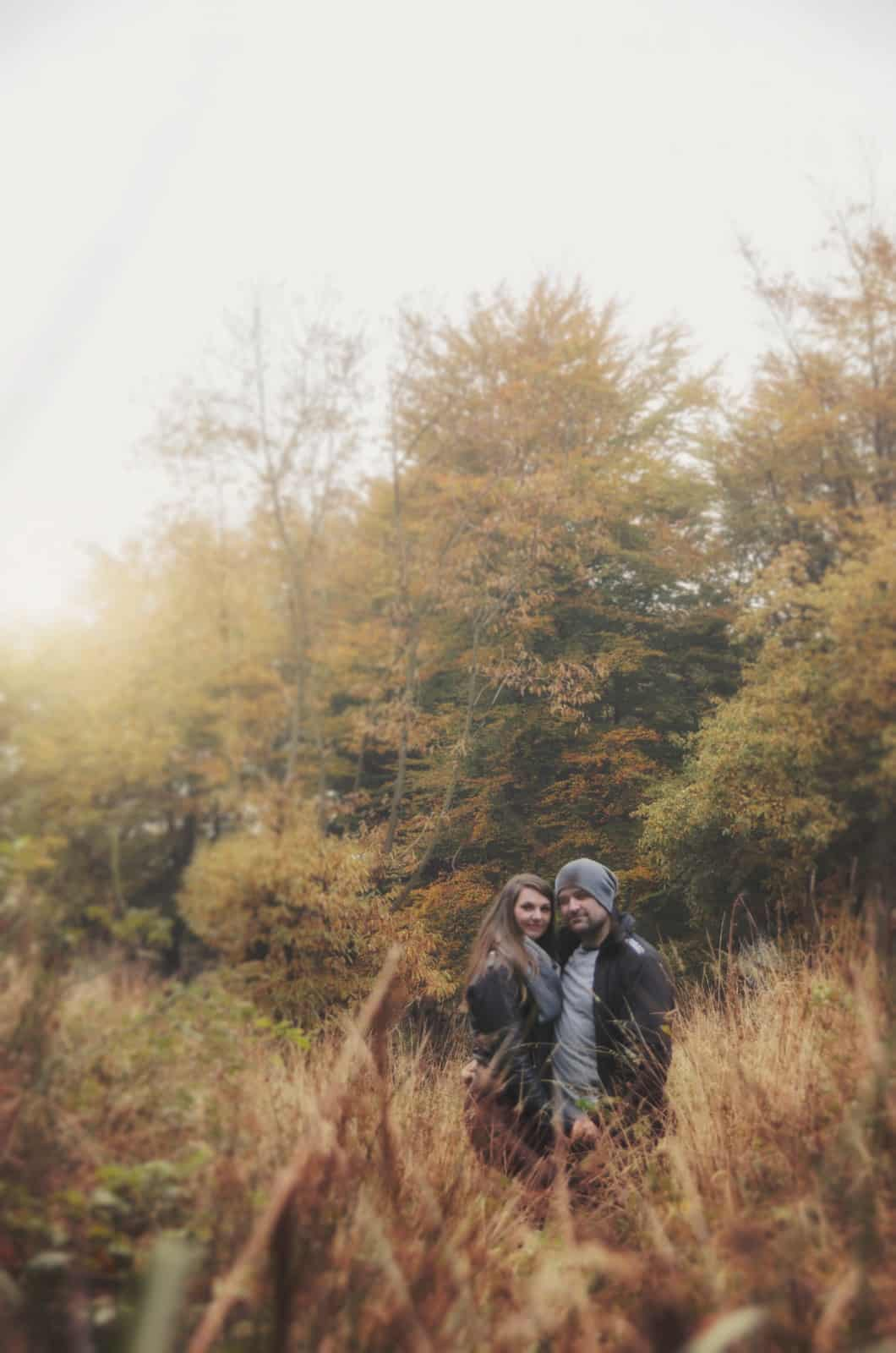 Couple stand in tall grass