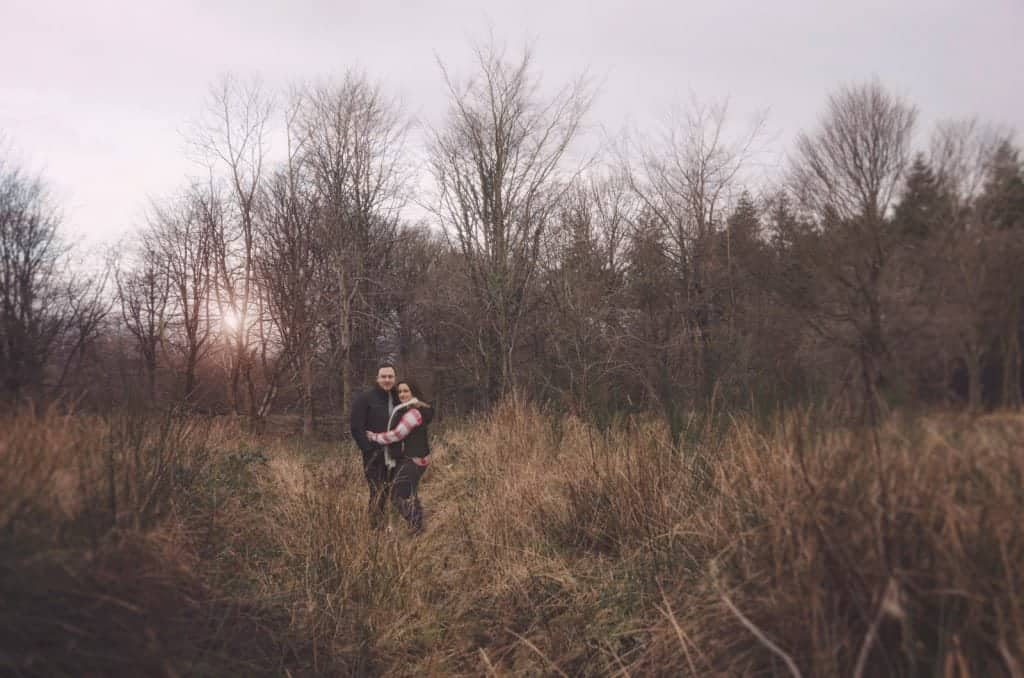 Couple stood in long grass