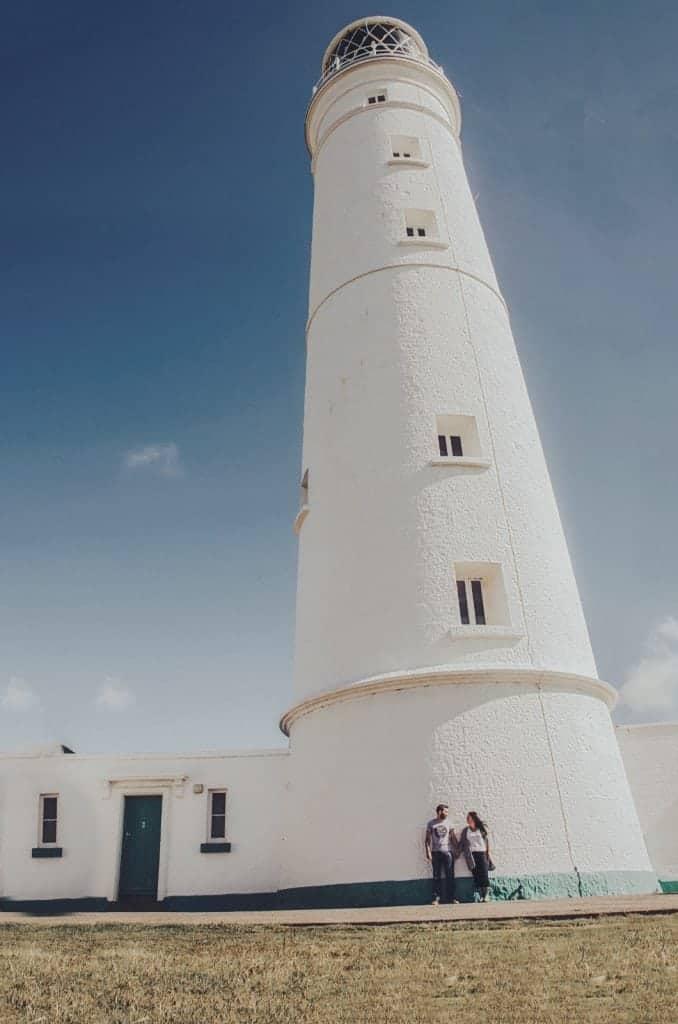 Couple stood outside a lighthouse