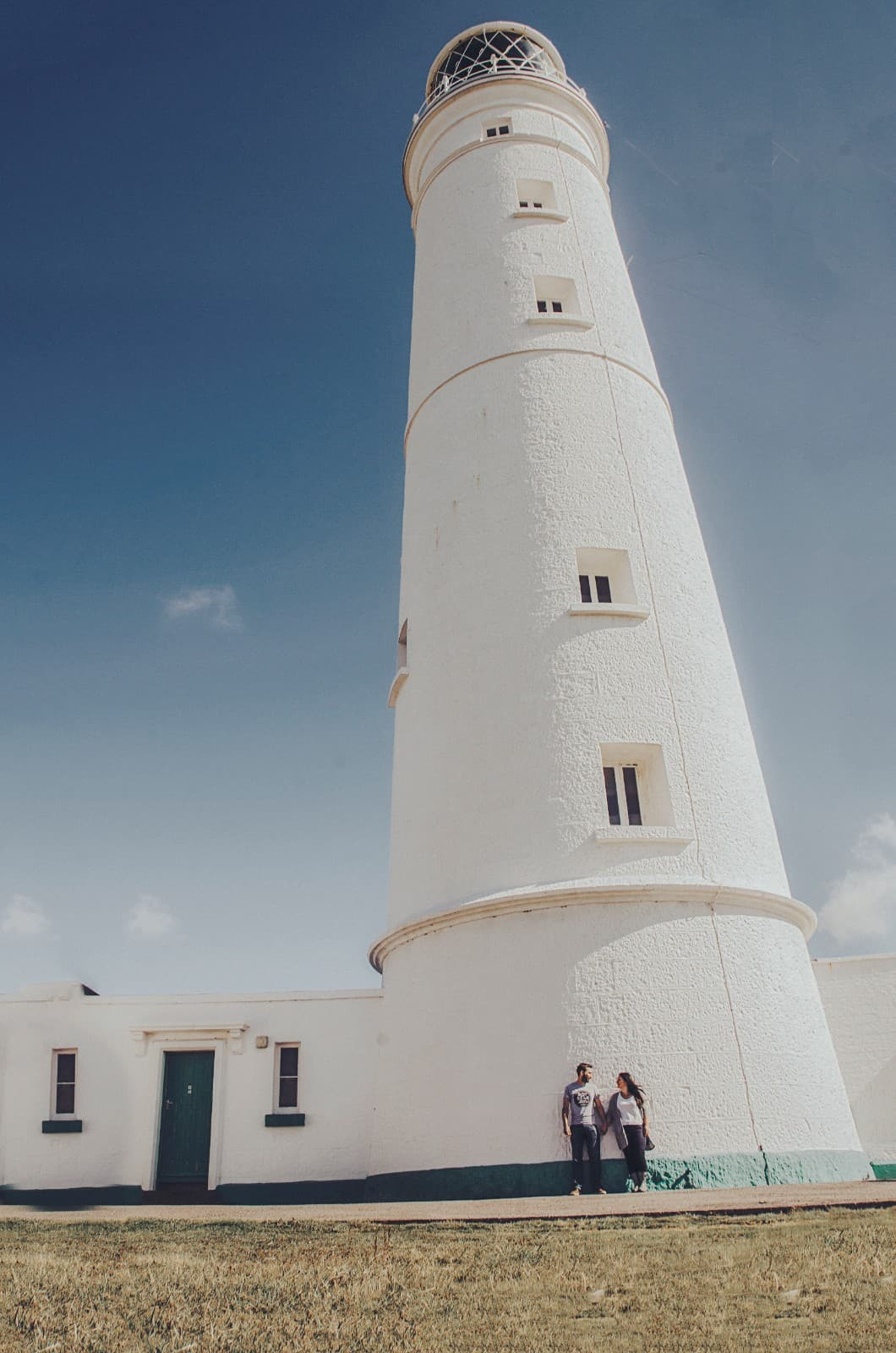 Couple stood outside a lighthouse