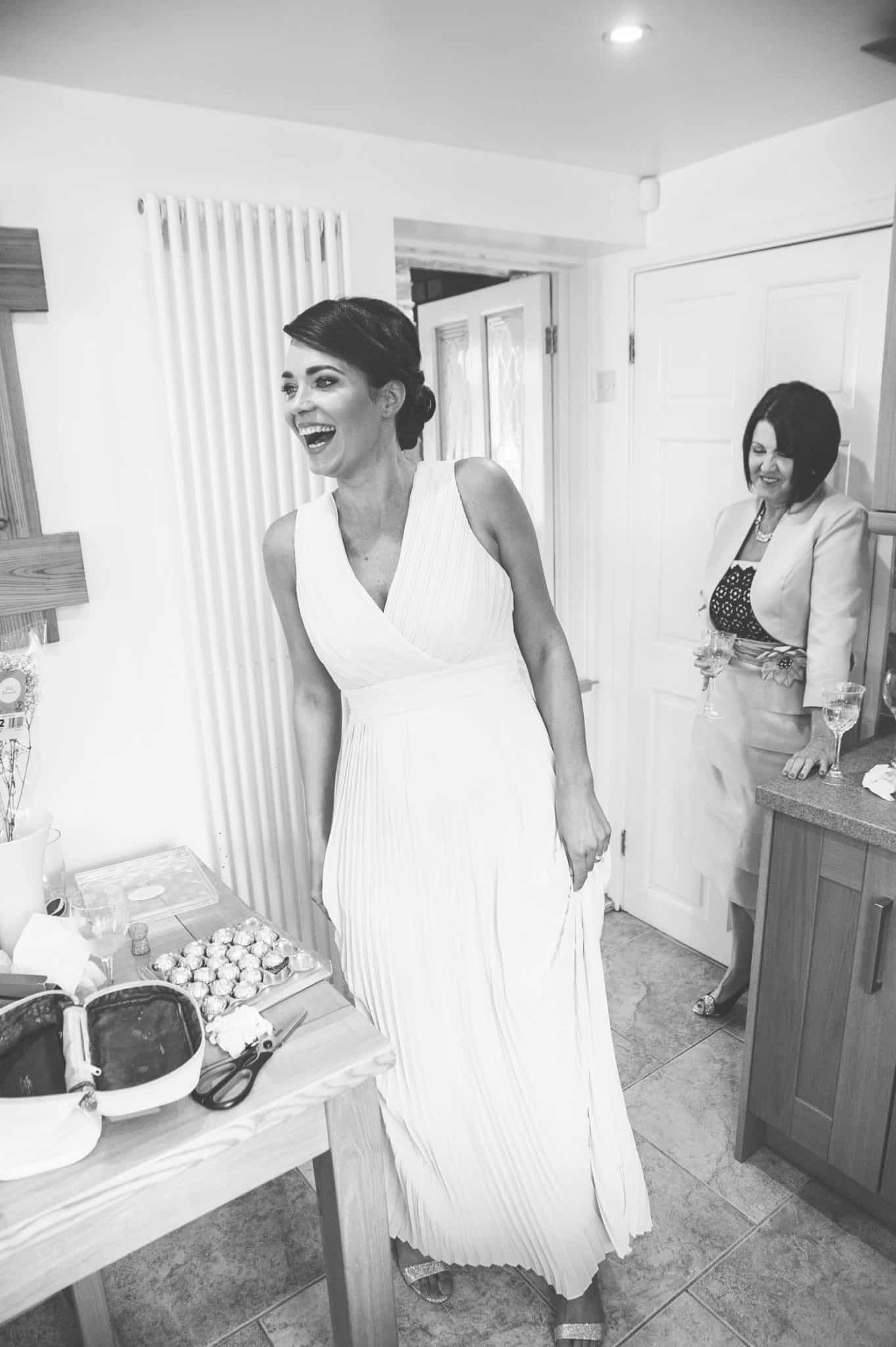 Bridesmaid laughing kitchen before wedding