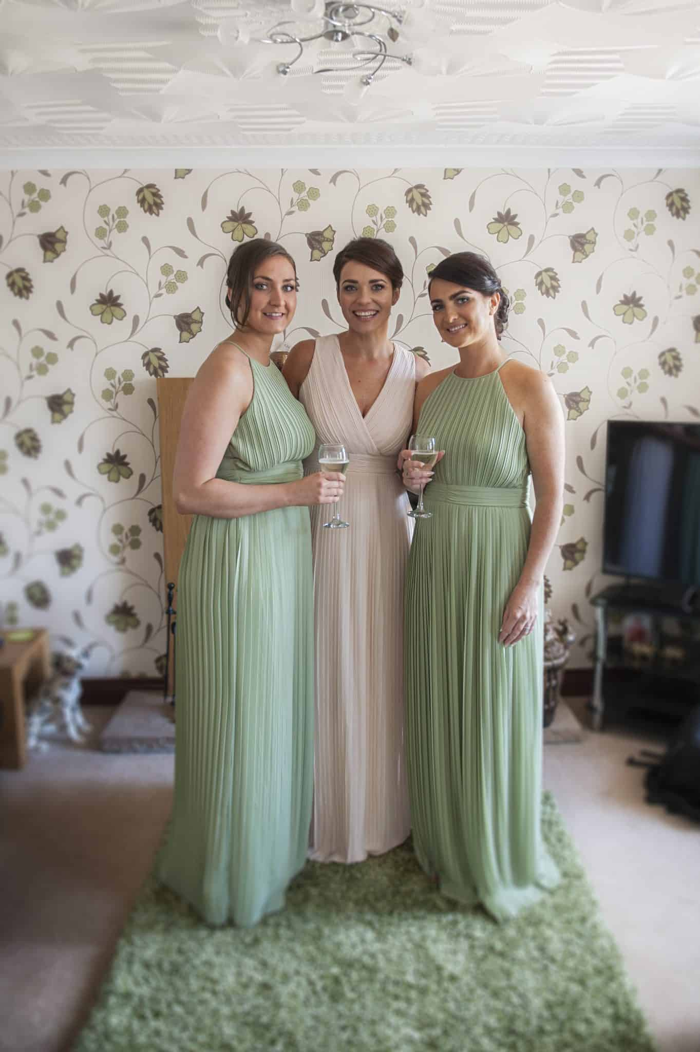 Bridesmaids stood in living room