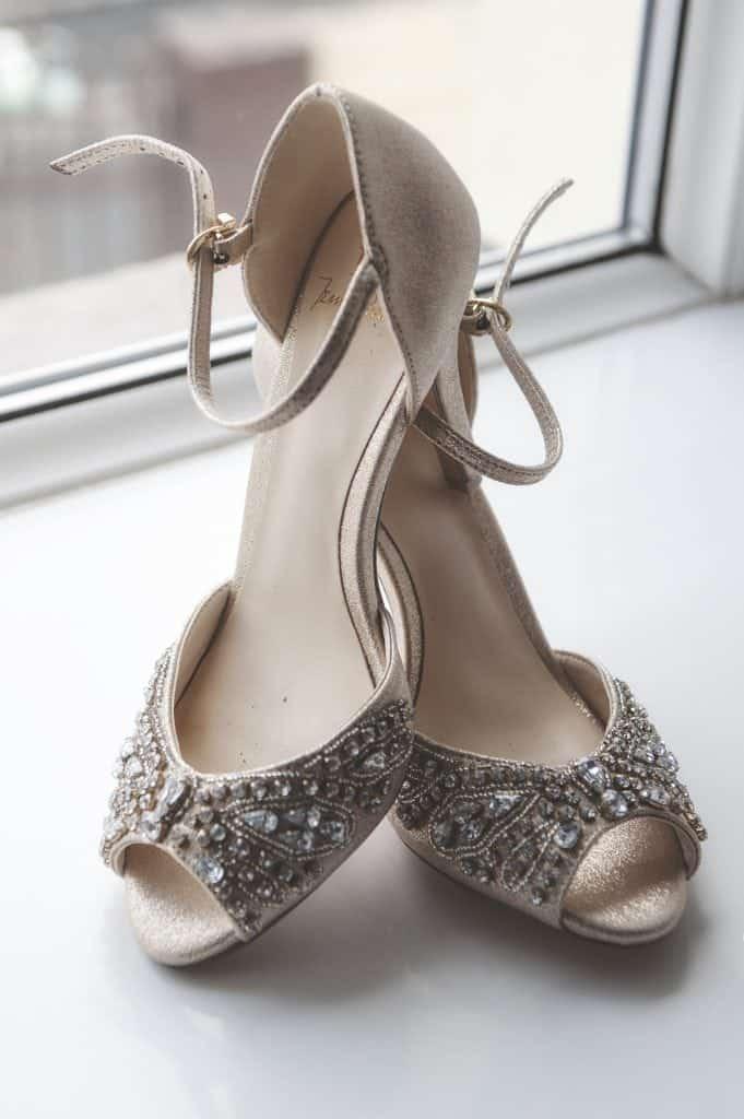 Bride's wedding shoes on windowsill
