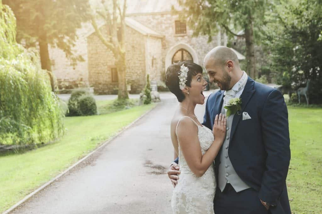 Bride & Groom stood on the pathway of Pencoed House Estate looking at each other