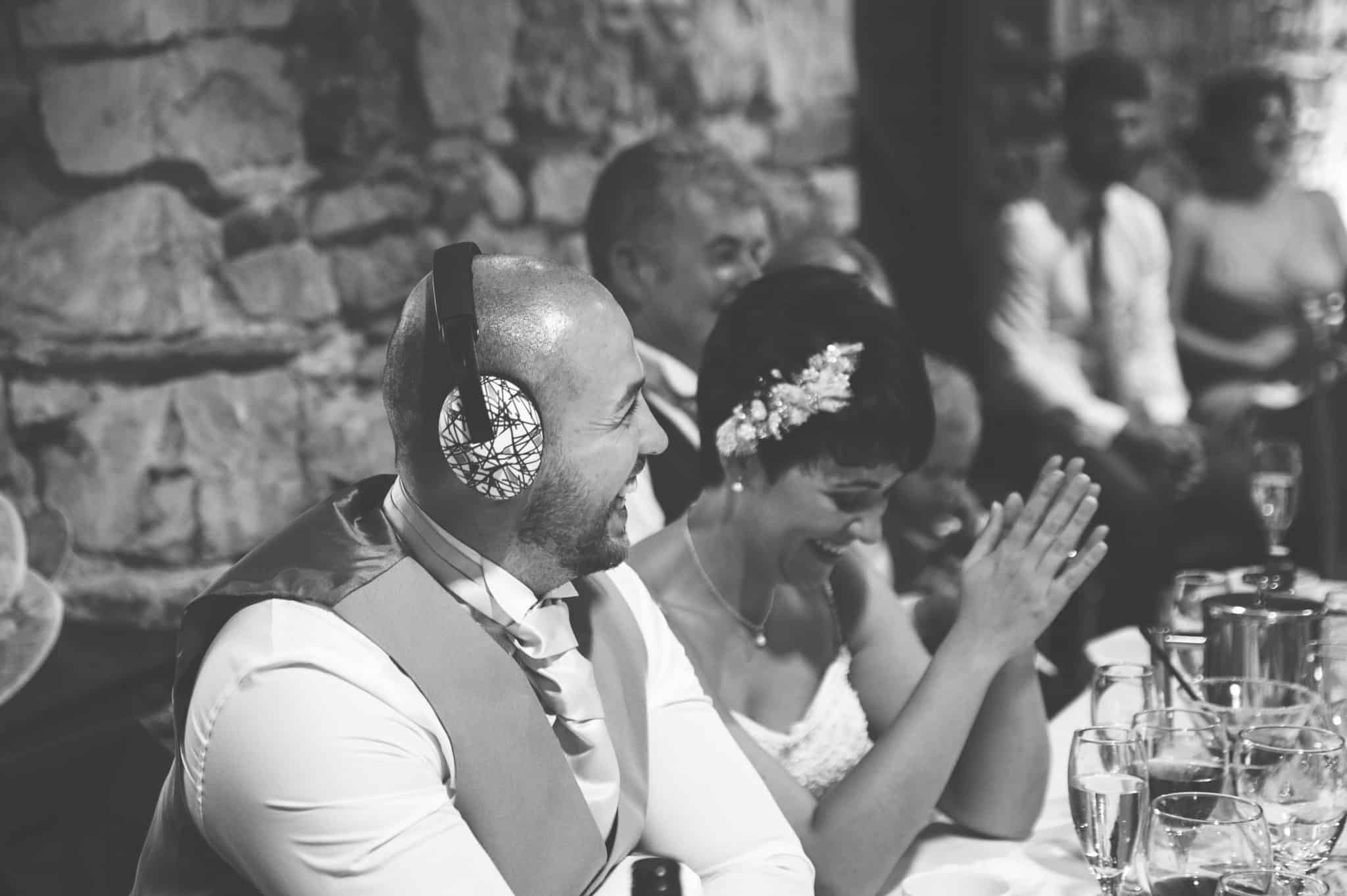 Groom sat at head table with headphones on
