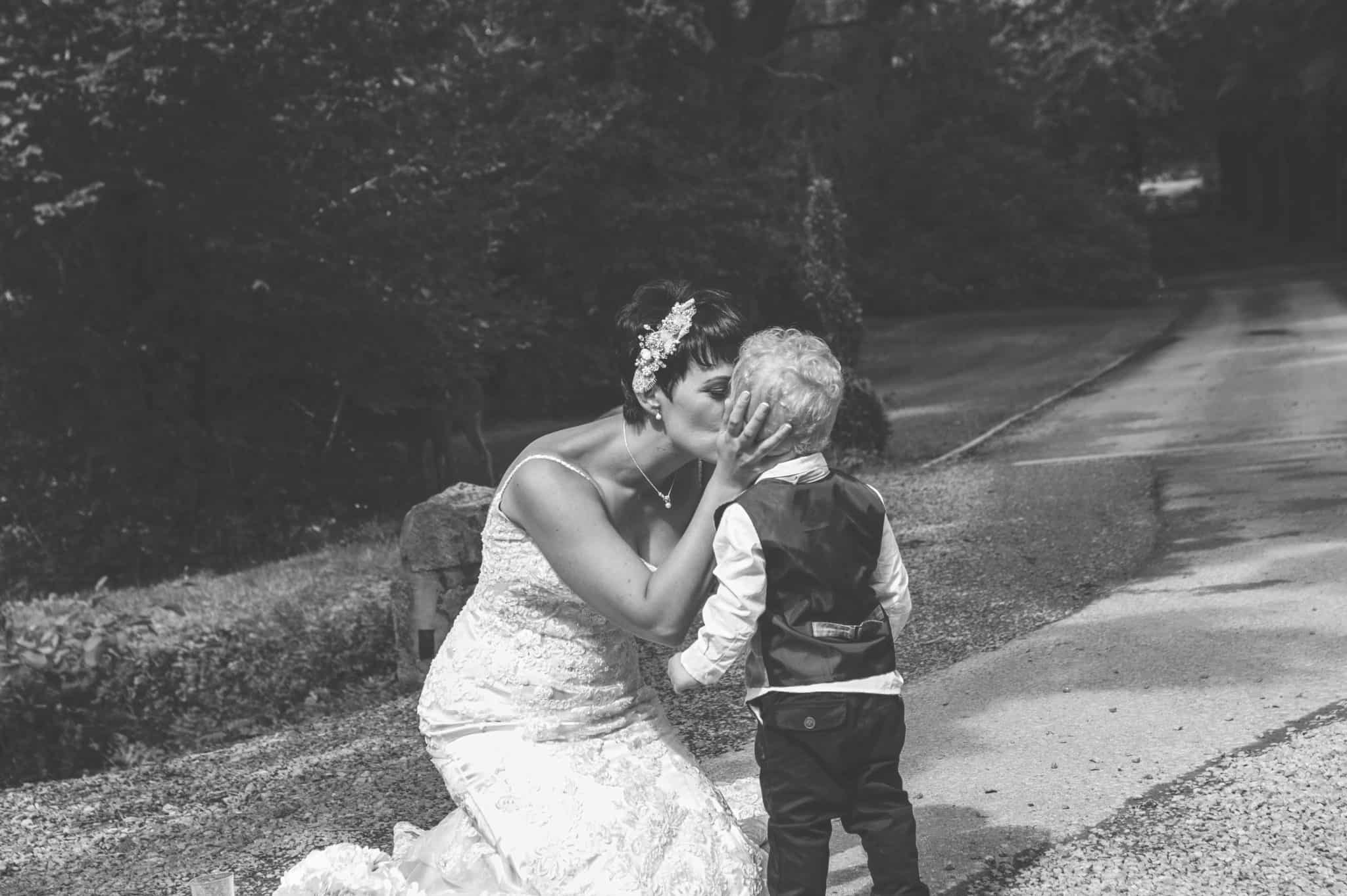 Bride kissing page boy