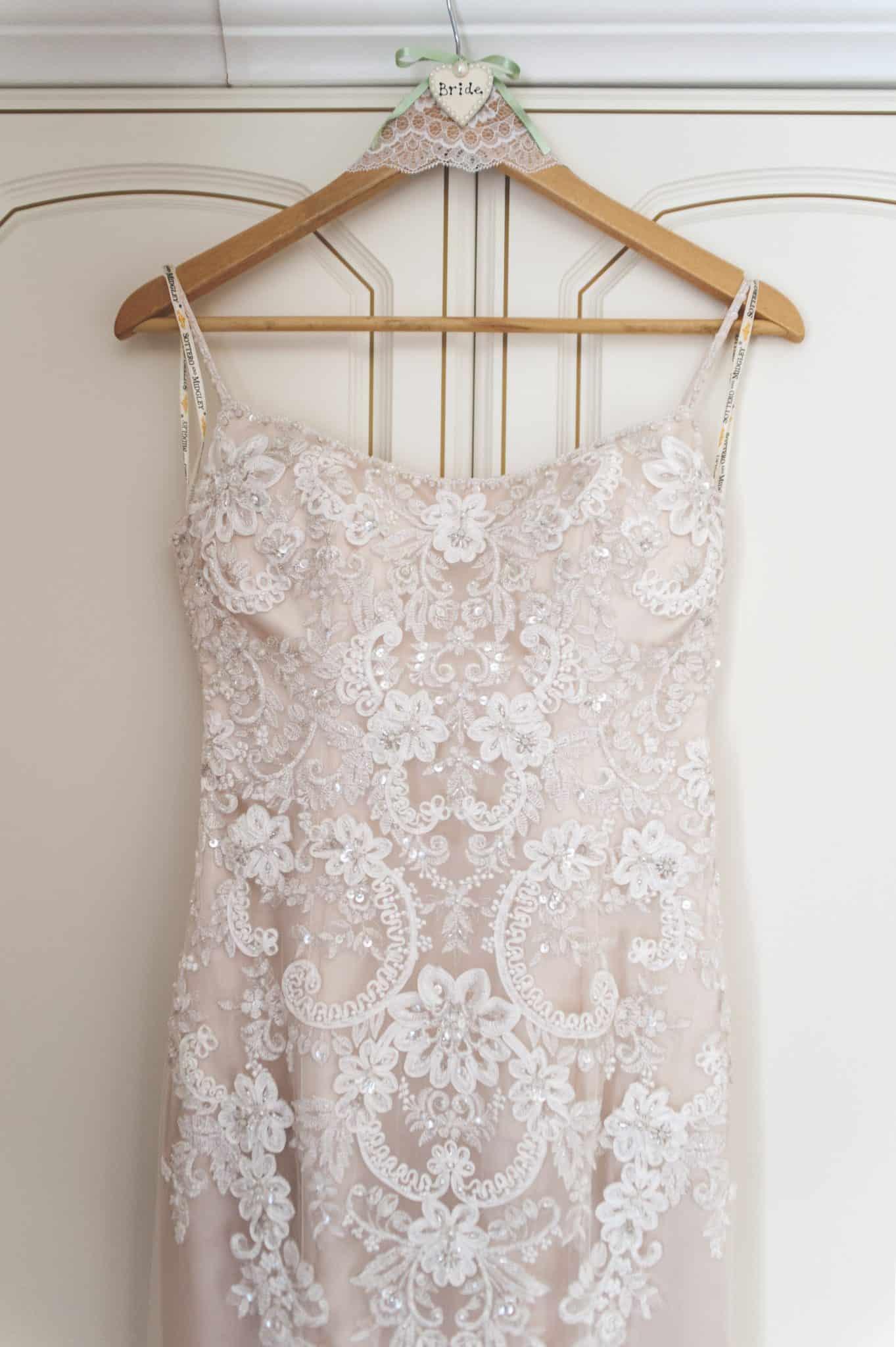 Wedding dressing hanging on cupboard