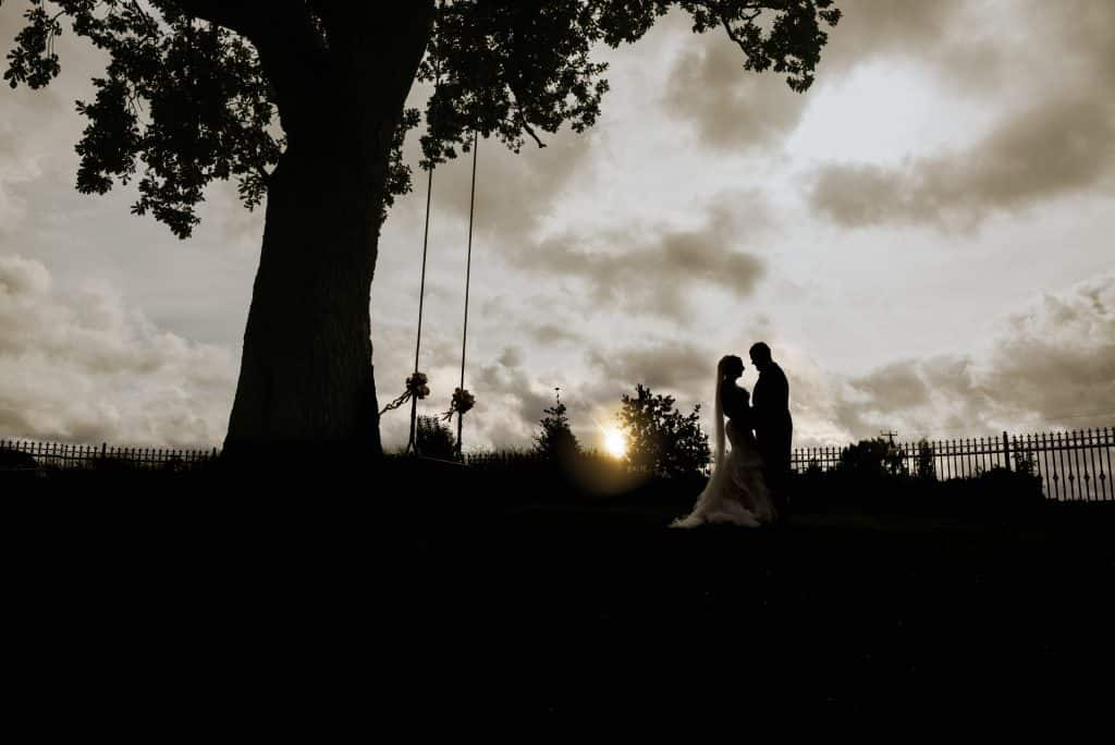 Bride & grom at sunset - wedding photographers cardiff