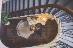 Bride & Groom Stood in a stair well kissing