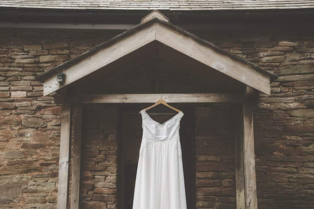 Wedding dressing hanging on the outside of a barn venue