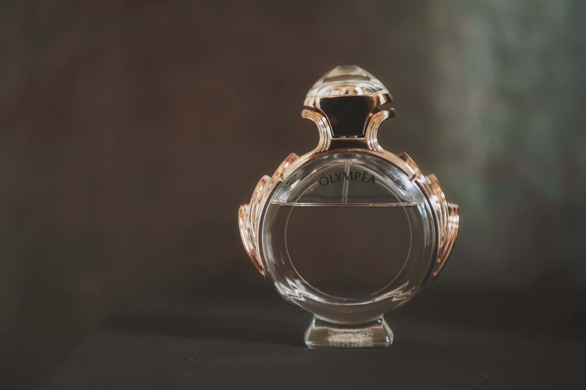 Bride's perfume bottle on a black stand