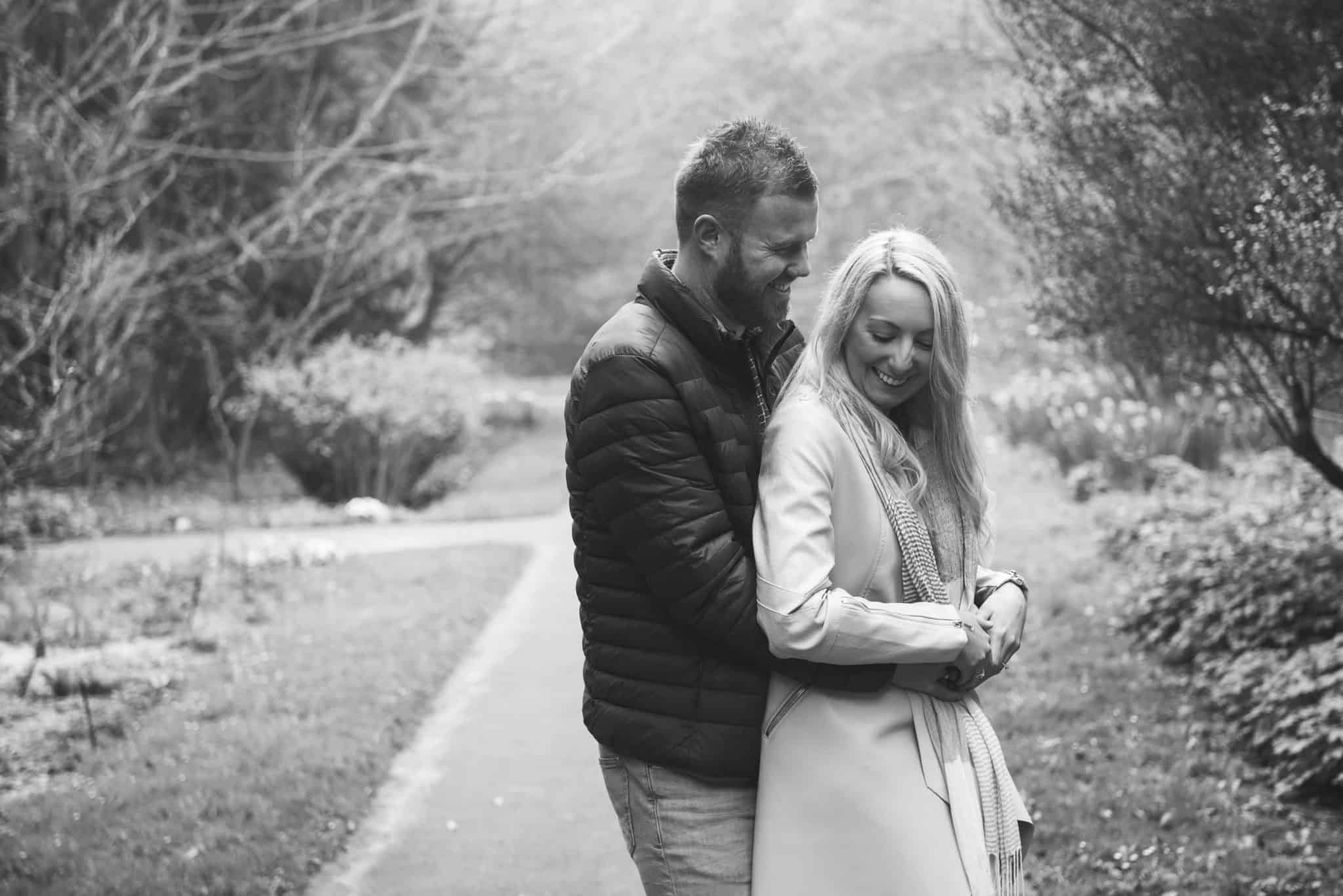 Couple laughing in walled gardens