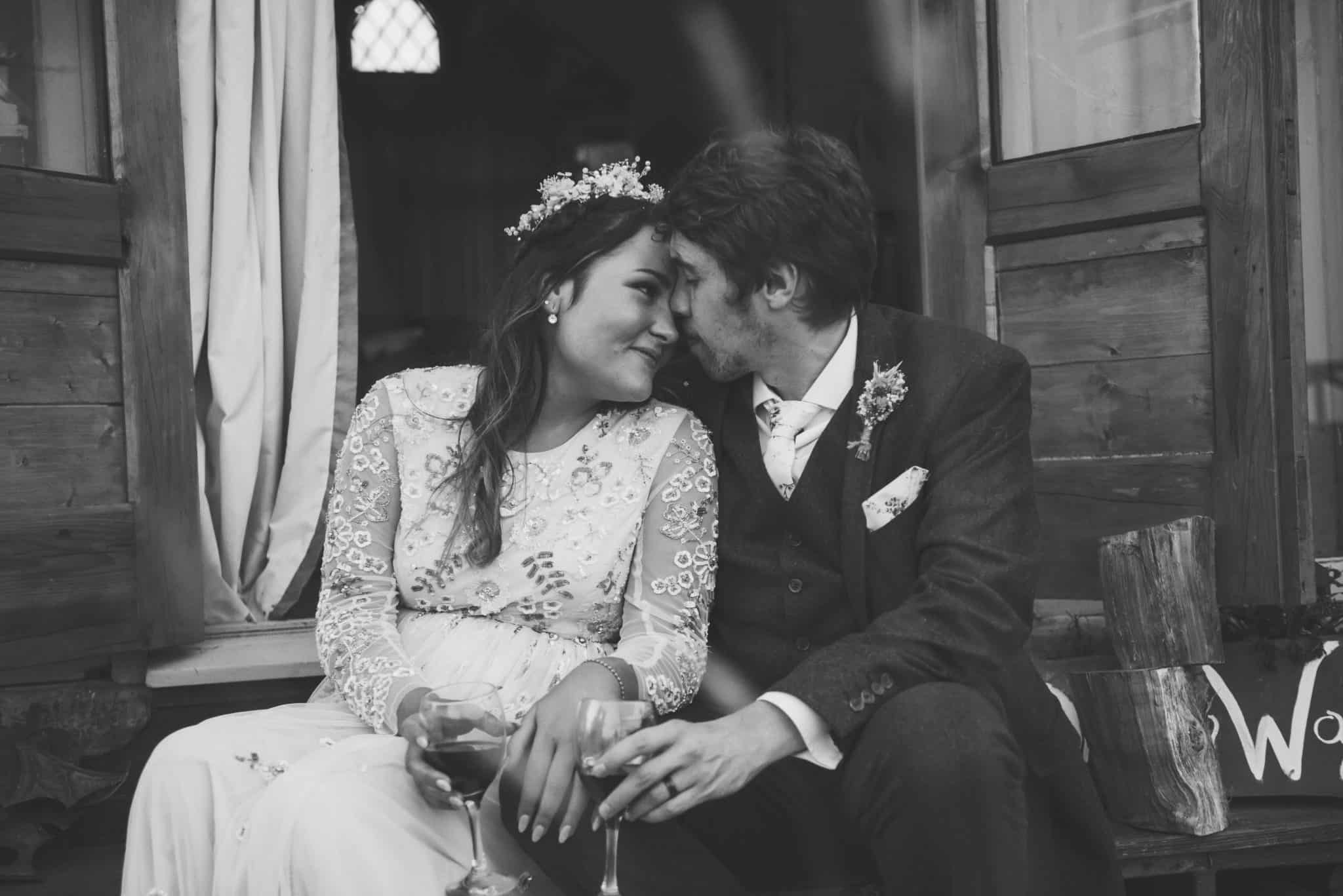 Best Wedding Photographer South Wales Bride and groom embrace sitting on a step