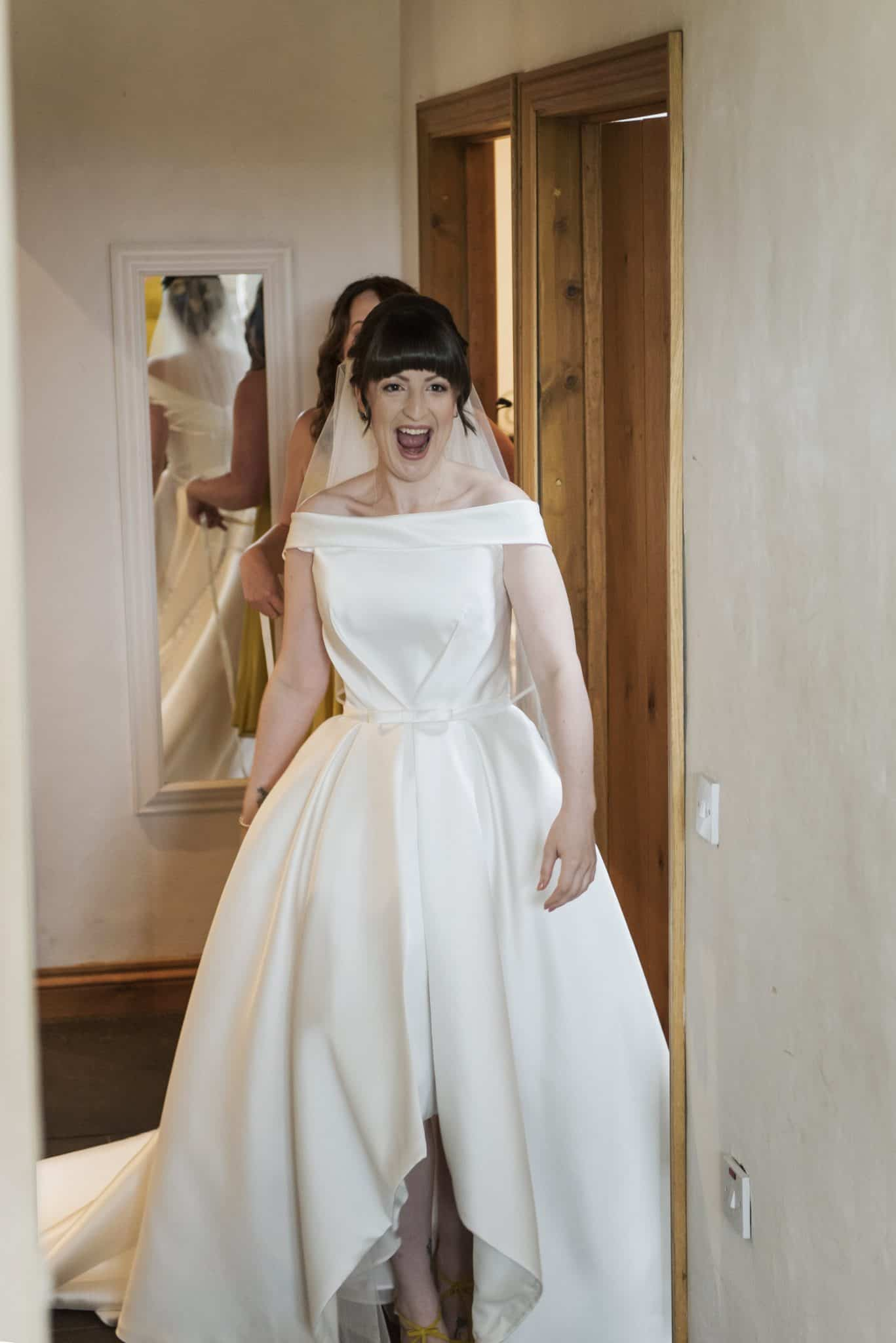 Bride smiling as she walks into room