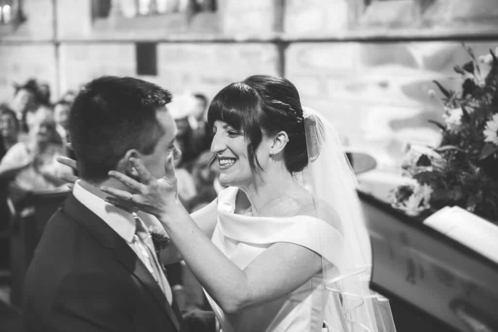 Bride holds grooms face