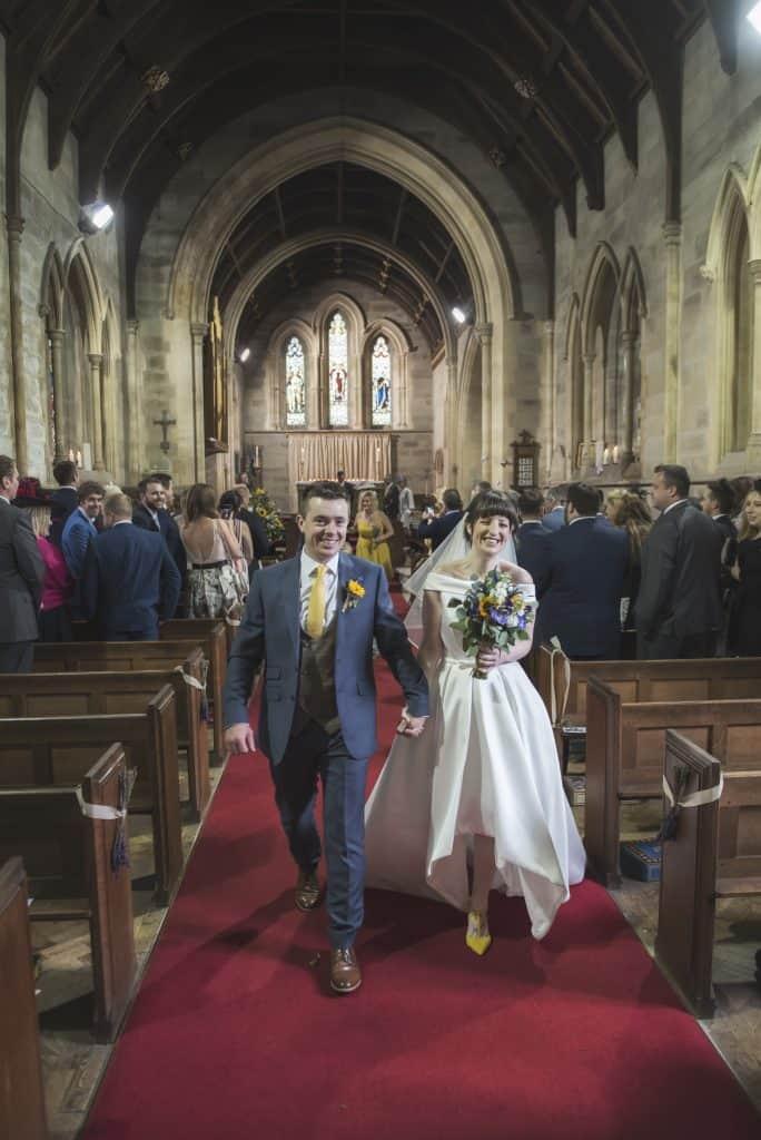 Bride & groom exiting church
