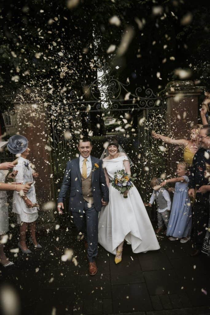 Bride & Groom walk through confetti
