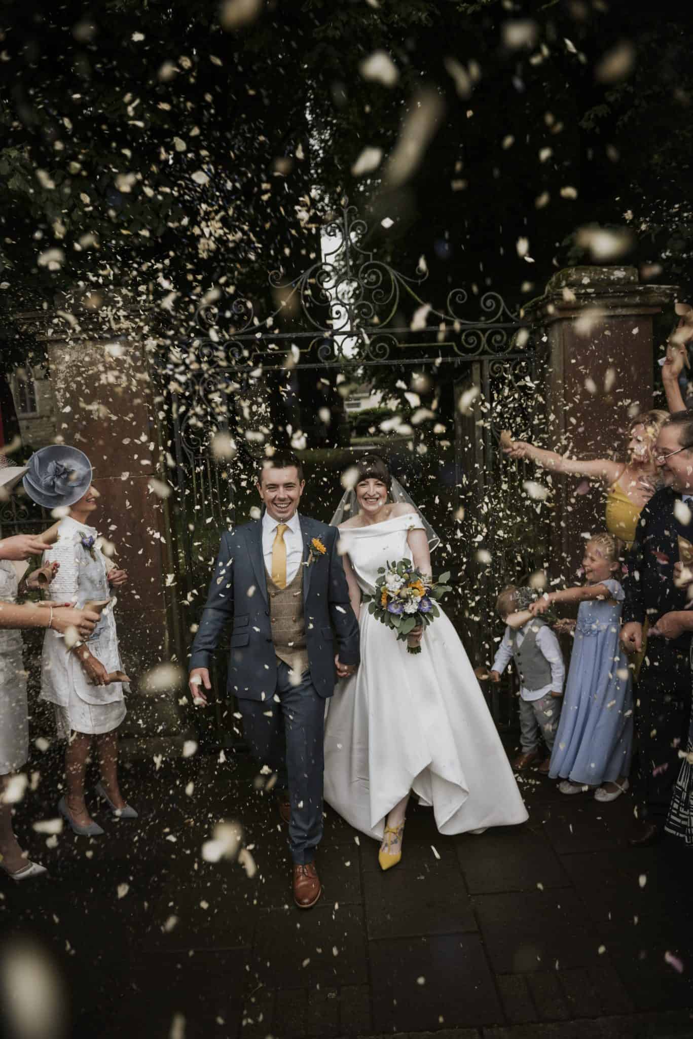 Bride & Groom walk through confetti