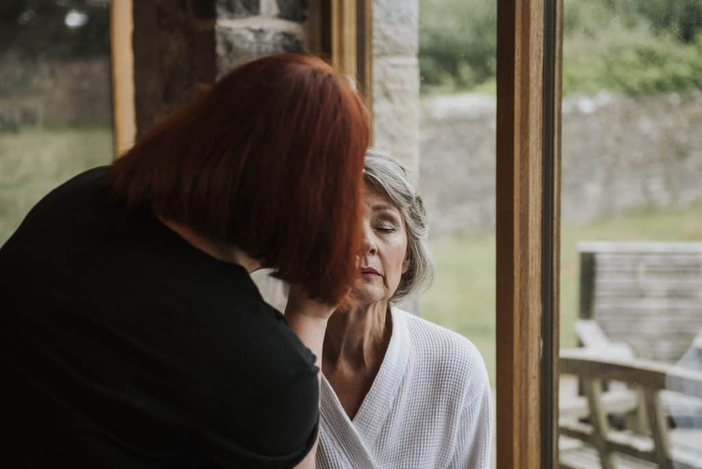 Mother of the bride having her makeup applied