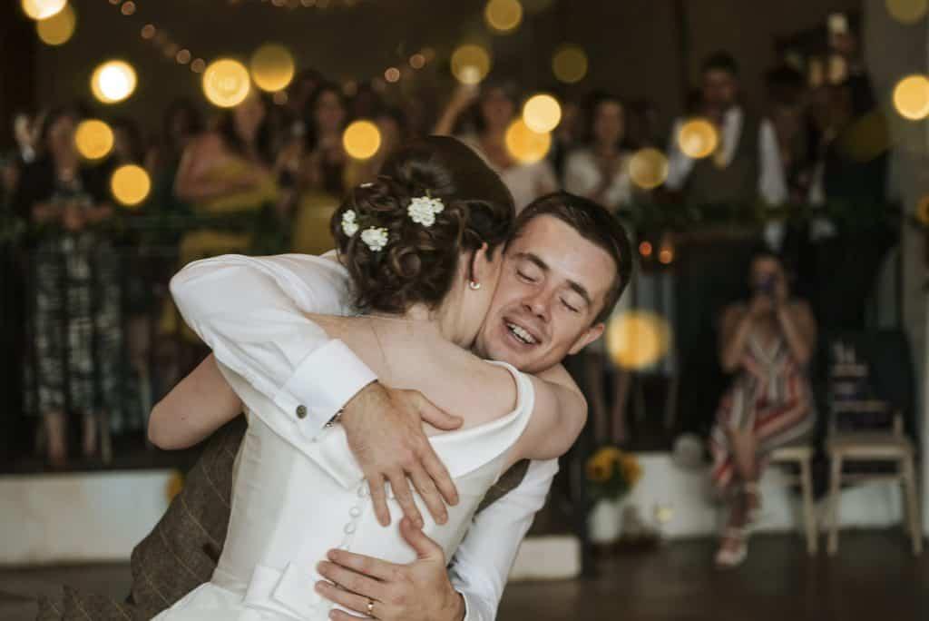 Bride & Groom hug on dance floor