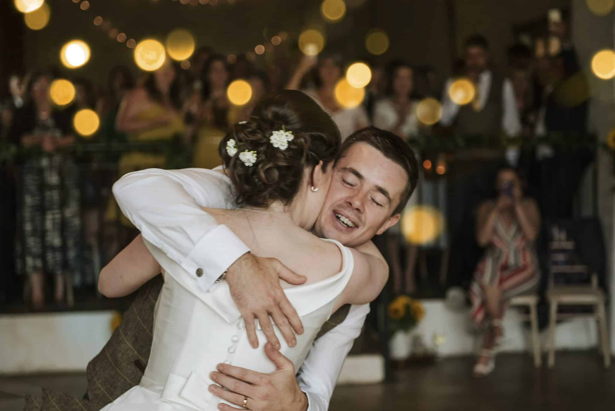 Bride & Groom hug on dance floor