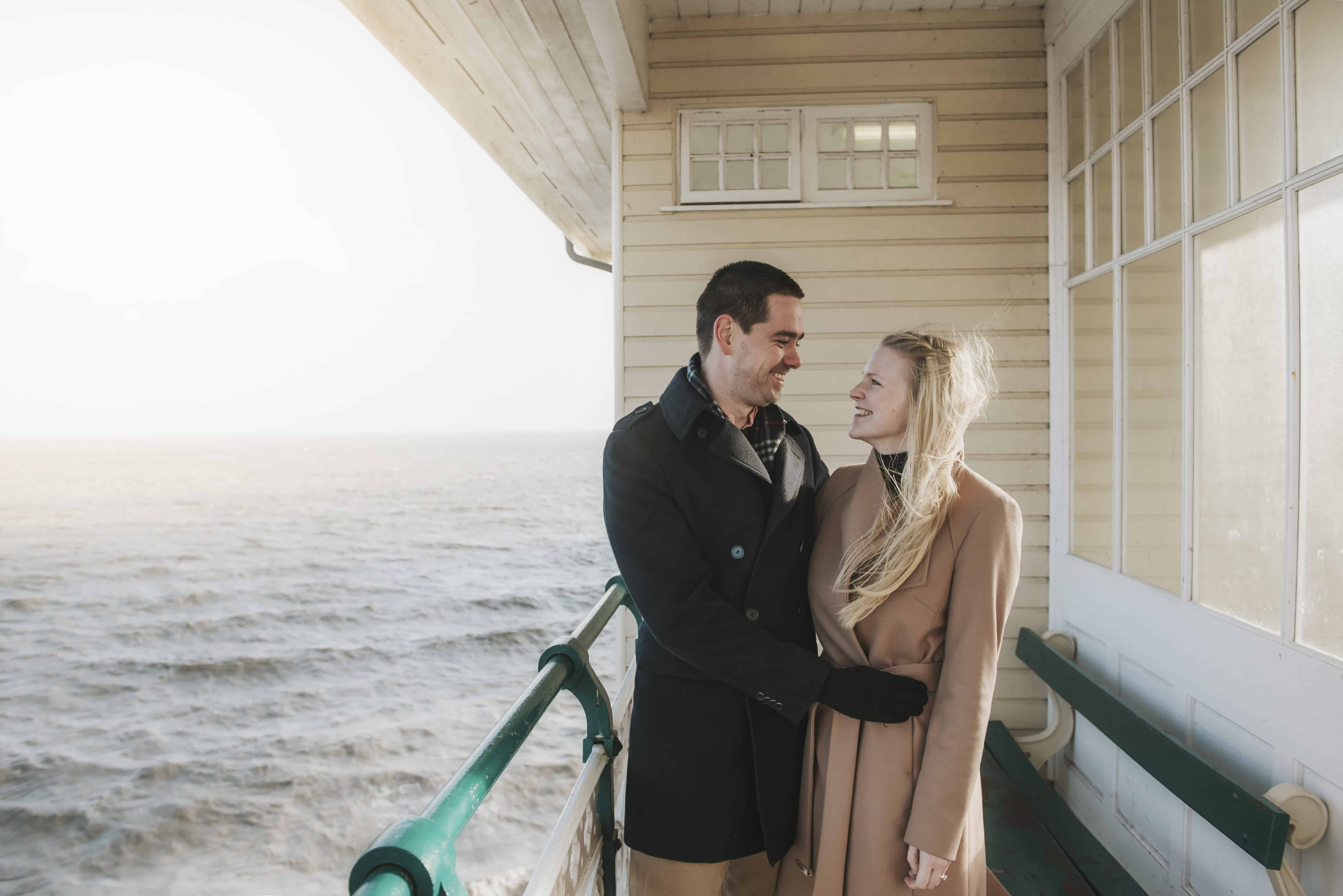 Couple stood on pier