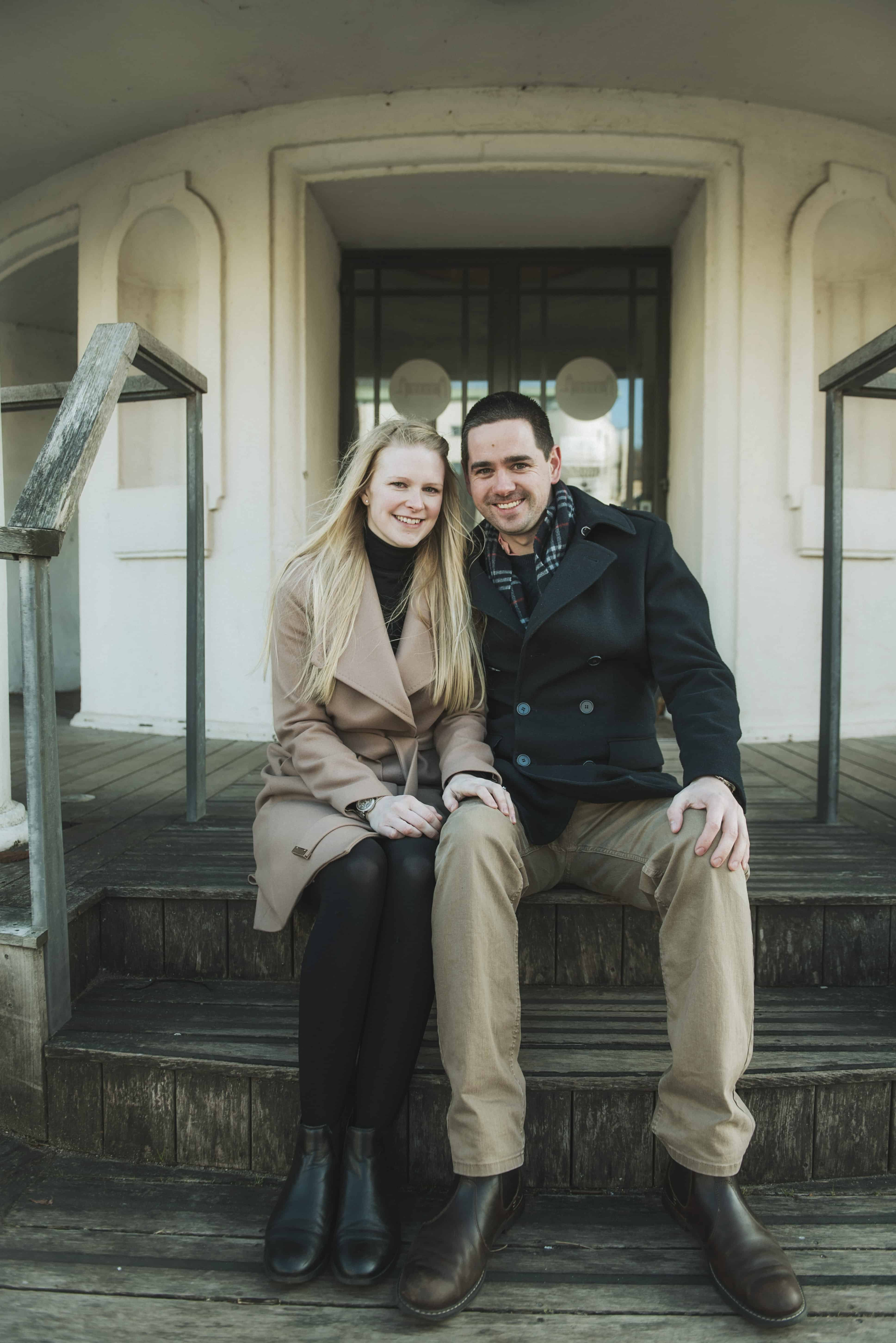 Couple sat on steps