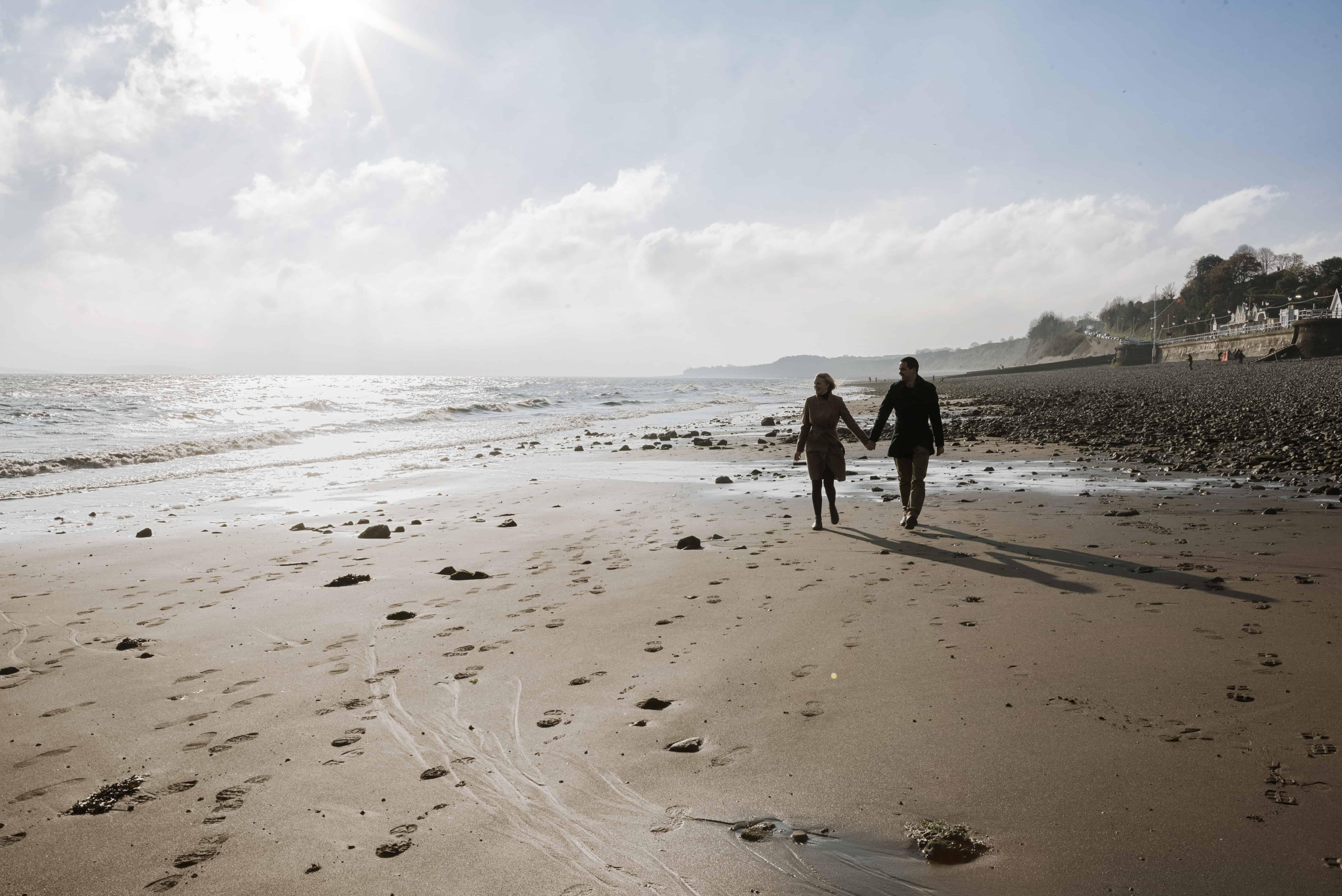 Couple walking sandy beach