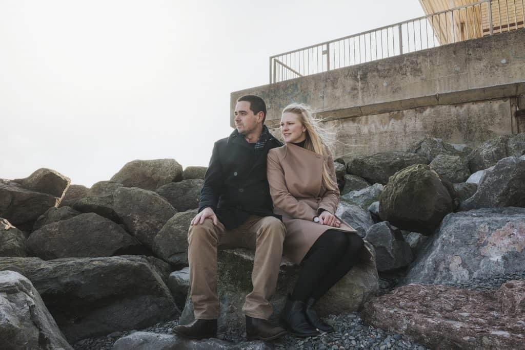 Couple sat on rockks at the beach