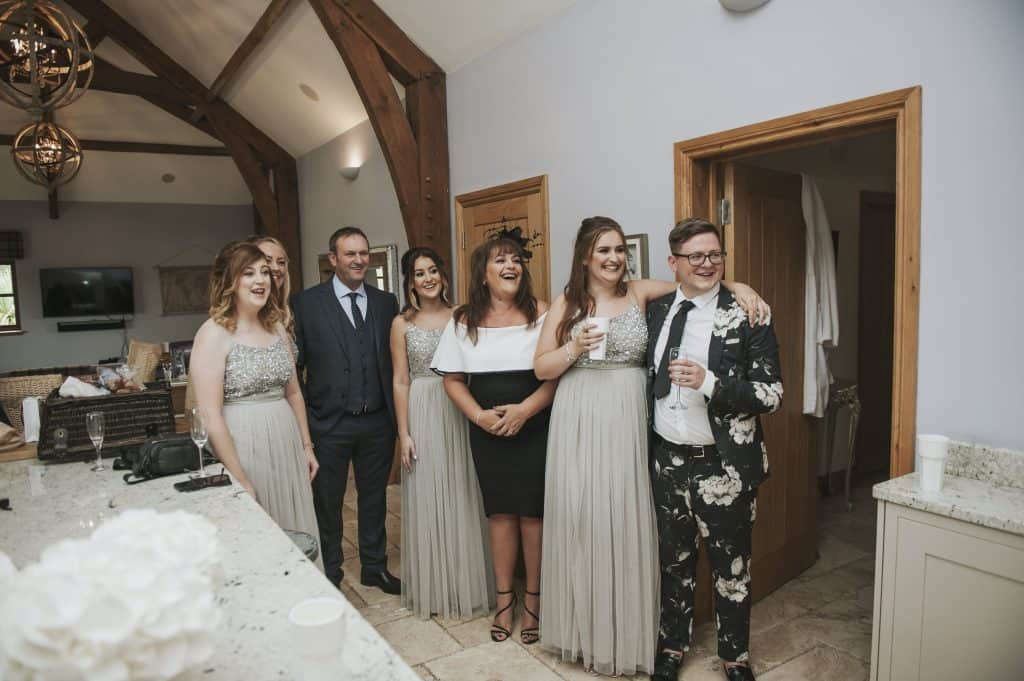 Wedding party smiling in cottage Oldwalls Wedding Photographer