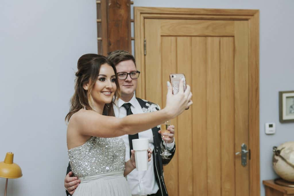 man & woman taking a selfie Oldwalls Wedding Photographer