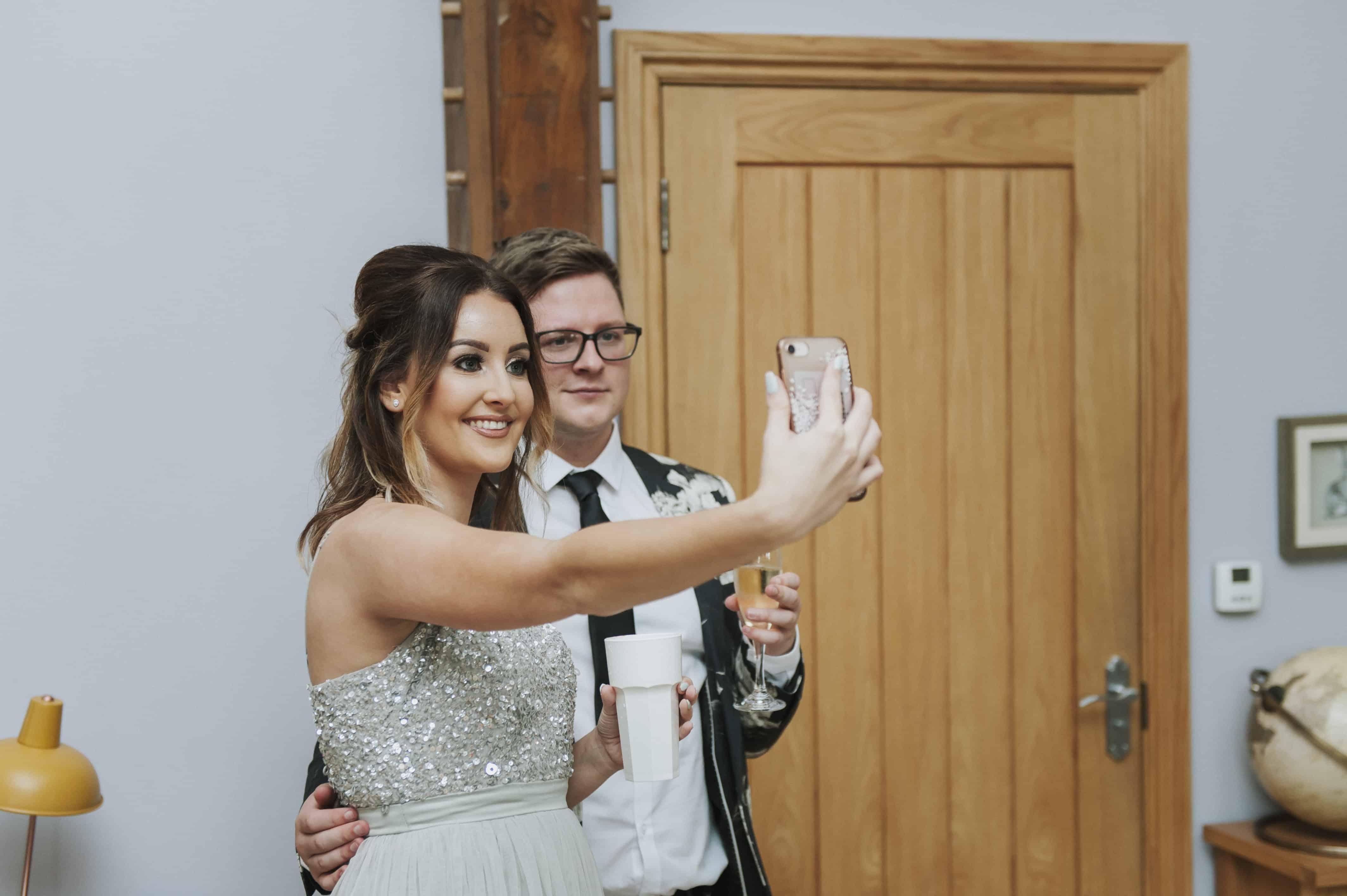 man & woman taking a selfie Oldwalls Wedding Photographer