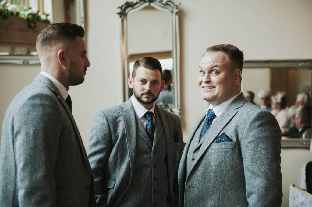 Groom and groomsmen looking at camera  Oldwalls Wedding Photographer